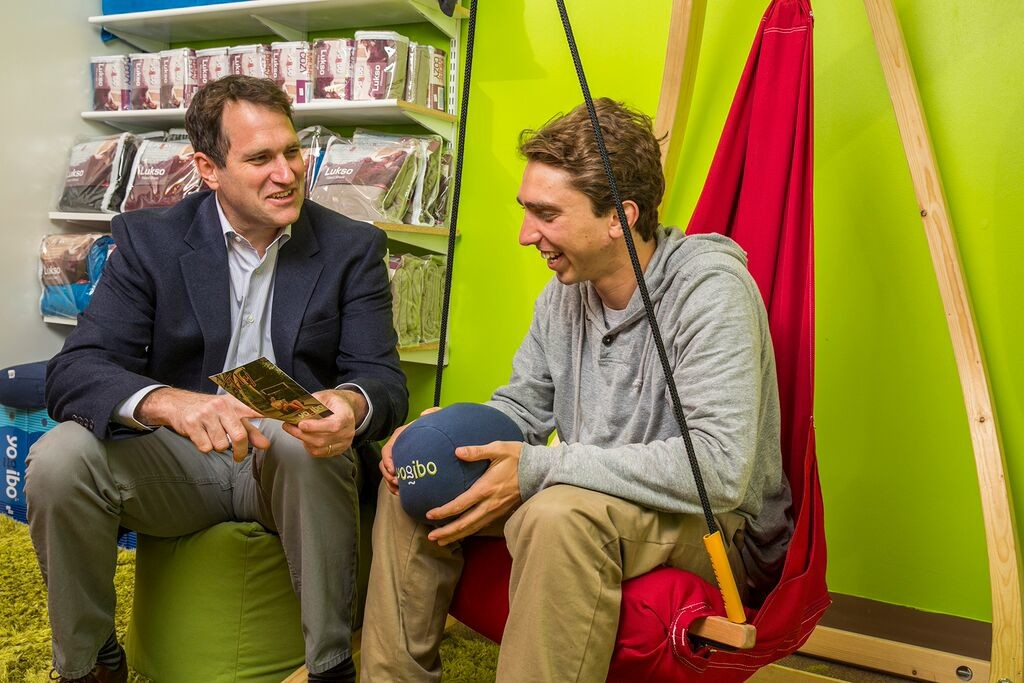 Yogibo founder Eyal Levy laughs with a customer at one of his 20+ retail locations in New England.